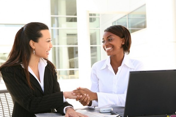 Women in Business Shaking Hands Partnering