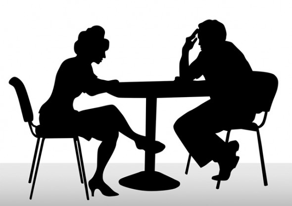two people talking at table