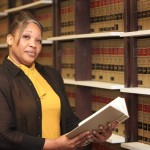 African American Attorney Woman in Law Library