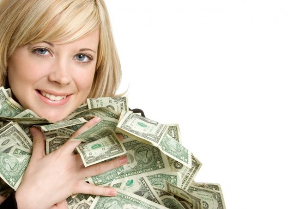 wealthy woman holding cash