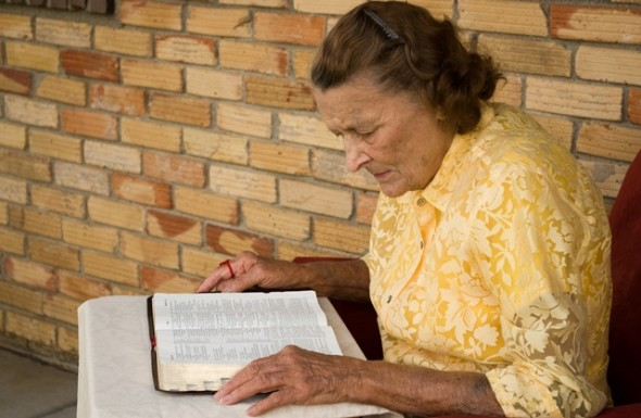 Elderly woman reading the Bible