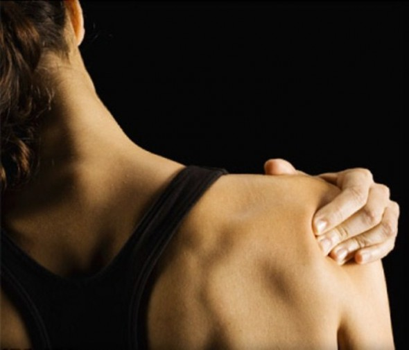 woman with sore muscles and pain