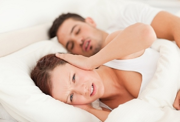 Man snoring & disturbing wife